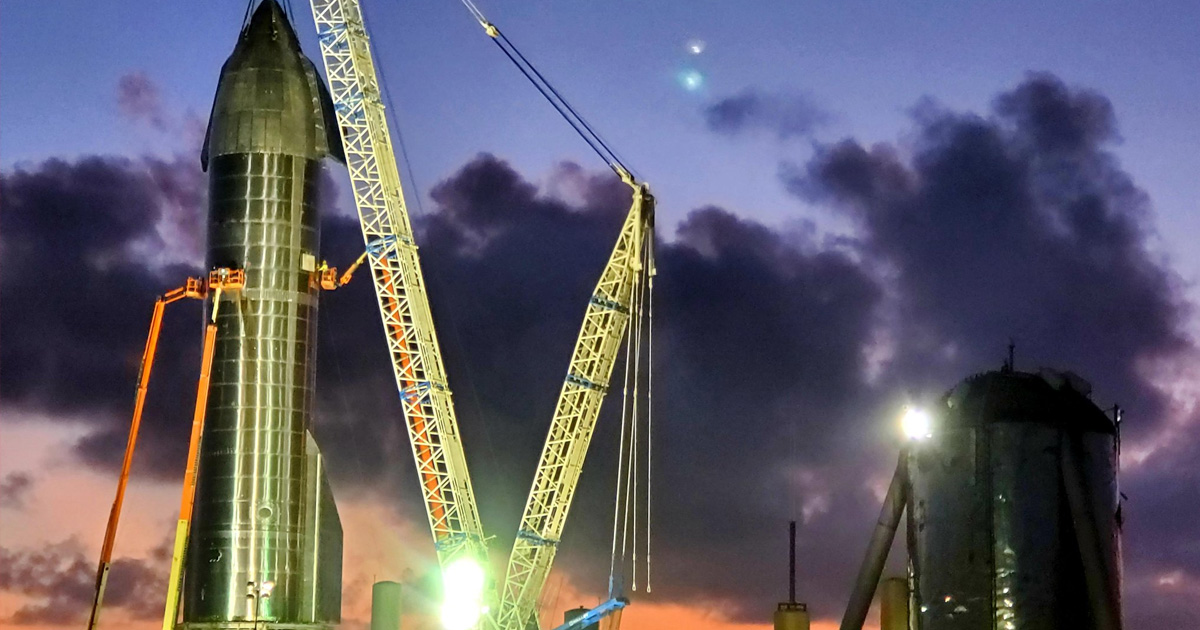 spacex installing nosecone starship fly 12 miles.
