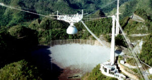 The massive alien hunting radio telescope at the Aericbo Observatory is at risk of collapse after several support cables failed leaving extensive damage.