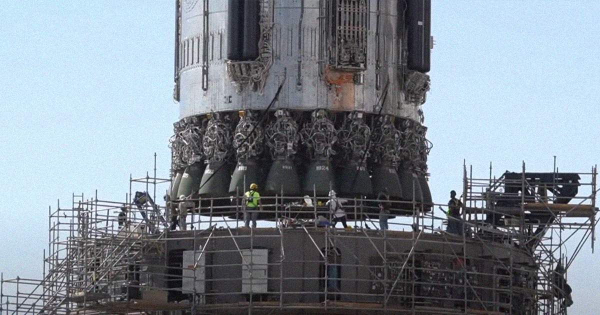 SpaceX Lifts Massive Starship Booster Onto Launchpad